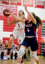 Pomperaug's Marina Lambiase (1) gets a shot off while being guarded by New Fairfield's Sydney O'Connor Emma Lyden (4) during their SWC game Tuesday at Pomperaug High School. Jim Shannon Republican American
