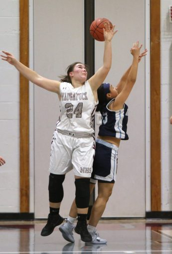 Naugatuck High School's Hailey Dehlebam and Ansonia High School's Hailey Bellido battle for the ball during the girls varsity basketball game in Waterbury on Wednesday night. Emily J. Reynolds. Republican-American