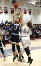 Ansonia High School's Natasha Rivera grabs a rebound over Naugatuck High School's Hailey Dehlebam during the girls varsity basketball game in Waterbury on Wednesday night. Emily J. Reynolds. Republican-American