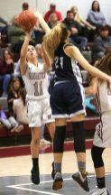 Naugatuck High School's Mia Rotatori goes up for a shot over Ansonia High School's Natasha Rivera during the girls varsity basketball game in Waterbury on Wednesday night. Emily J. Reynolds. Republican-American