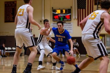 Gilbert's Dylan Crowley #33 dribbles past Thomaston's Chad Suckley #34 with Thomaston's Ian Bethin #23 looking on during a BL Boys Basketball game between Gilbert and Thomaston at Thomaston High School in Thomaston on Friday. Bill Shettle Republican-American