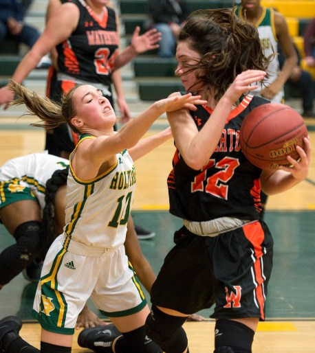 WATERBURY, CT-011819JS12- Holy Cross' Alyssa Hebb (10) dives to try to steal the ball from Watertown's Nicole DeFeo (12) during their game Friday at Holy Cross High School. Jim Shannon Republican American