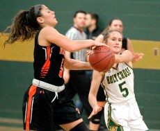 WATERBURY, CT-011819JS13- Holy Cross' Allie Brown (5) causes a turnover while defending Watertown's Jordyn Forte (5) during their game Friday at Holy Cross High School. Jim Shannon Republican American