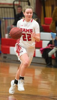 Cheshire's Mia Juodaitis (22) pushes the ball up court after a steal during their game against Hillhouse Tuesday at Cheshire High School. Jim Shannon Republican American