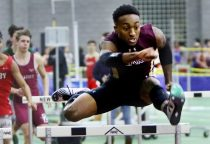 Edward Williams Jr. of Sacred Heart competes in the 55 meter Hurdles during the NVL indoor track championships in New Haven Monday. Steven Valenti Republican-American