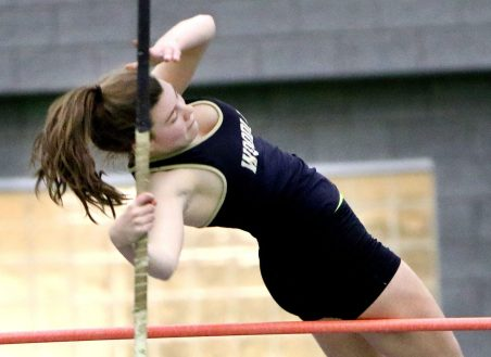 Hailey Bernier of Woodland High competes in the pole vault during the NVL indoor track championships in New Haven Monday. Steven Valenti Republican-American