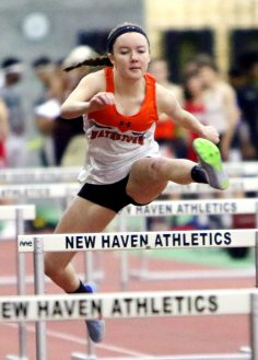 Morgan Dodge of Watertown High competes in the 55 meter Hurdles during the NVL indoor track championships in New Haven Monday. Steven Valenti Republican-American