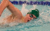 Holy Cross' Chris Ford took first in the 500 freestyle with a time of 5:06.75 during their meet with Woodland Friday at the John Reardon Pool at Kennedy High School in Waterbury. Jim Shannon Republican American