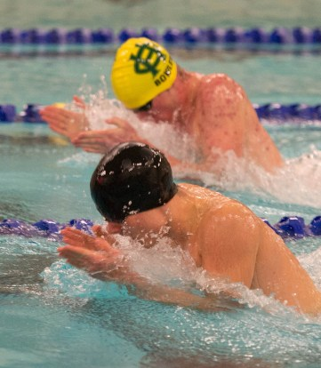 Woodland's Greg Aldrich and Holy Cross' Ben Bowler compete in the 100 breaststroke during their meet Friday at the John Reardon Pool at Kennedy High School in Waterbury. Aldrich won the event with a time of 1:05.85 Jim Shannon Republican American