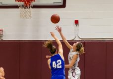 Naugatuck's Sarah Wisniewski #0 drives to the basket against Bristol Eastern's Avery Arbuckle #42, during a second round tournament game in the Girls Class L Basketball Championships between Bristol Eastern and Naugatuck at Naugatuck High School in Naugatuck on Thursday. Bill Shettle Republican-American