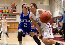 Naugatuck's Shannon Burns #5 drives the baseline against Bristol Eastern's Paige McLaughlin #2, during a second round tournament game in the Girls Class L Basketball Championships between Bristol Eastern and Naugatuck at Naugatuck High School in Naugatuck on Thursday. Bill Shettle Republican-American