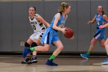 Oxford's Molly Sastram #10 dribbles around and past the defense of Woodland's Gabby Mastropietro #10 during a Girls NVL Basketball game between Oxford and Woodland at Woodland Regional High School in Beacon Falls on Saturday. Oxford came back after being down by 10 at half to beat Woodland 42-39. Bill Shettle Republican-American