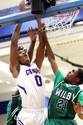 #0 Kerwin Prince of Crosby High puts up a basket over #21 Zohnarius Shelton of Wilby High during NVL basketball action in Waterbury Monday. Steven Valenti Republican-American