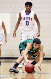 #23 Jonathan Matias of Wilby High controls the loose ball against Crisby High during NVL basketball action in Waterbury Monday. Steven Valenti Republican-American
