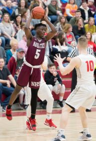 Naugatuck's John Lukau (5) dishes the ball off during their NVL game against Wolcott Tuesday at Wolcott High School. Jim Shannon Republican American