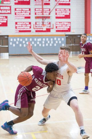 Naugatuck's Gwayne Fisher (2) drives into the chest of Wolcott's Jeff Nicol (10) while driving to the basket during their NVL game Tuesday at Wolcott High School. Jim Shannon Republican American