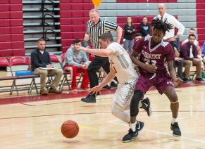 Naugatuck's Ese Onakpoma (33) slams into Wolcott's Christopher Harris (13) while Harris runs down a loose ball during their NVL game Tuesday at Wolcott High School. No foul was called on the play Jim Shannon Republican American