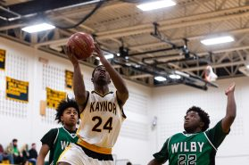 Kaynor Tech's Saijan McIntosh #24 goes to the basket with Wilby's Jeremiah Tripp #11, and Raekwon James #22 looking on during a non-league boys basketball game between Wilby and Kaynor Tech at Kaynor Tech High School in Waterbury on Wednesday. Kaynor Tech edged out Wilby at the end 68-58. Bill Shettle Republican-American