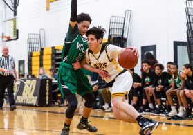 Kaynor Tech's Fernando Cerda #10 looks to drive the baseline against Wilby's Andres Urena #3 during a non-league boys basketball game between Wilby and Kaynor Tech at Kaynor Tech High School in Waterbury on Wednesday. Kaynor Tech edged out Wilby at the end 68-58. Bill Shettle Republican-American