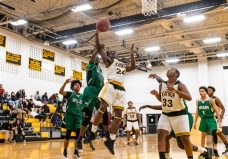 Kaynor Tech's Saijan McIntosh #24 gets fouled by Wilby's Zoharius Shelton, going to the basket, during a non-league boys basketball game between Wilby and Kaynor Tech at Kaynor Tech High School in Waterbury on Wednesday. Kaynor Tech edged out Wilby at the end 68-58. Bill Shettle Republican-American