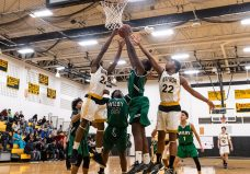 Kaynor Tech's Saijan McIntosh #22, left, and Nashua Lovett #22, right, battle with Wilby's Shariff Bilewu #13 for a rebound during a non-league boys basketball game between Wilby and Kaynor Tech at Kaynor Tech High School in Waterbury on Wednesday. Kaynor Tech edged out Wilby at the end 68-58. Bill Shettle Republican-American