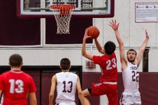 Wolcott's Elwin Redzepagic #23 puts back a rebound in front of Torrington's Kevin Dixon #22 during A Boys NVL Iron Division basketball game between Wolcott and Torrington at Torrington High School in Torrington on Thursday. Torrington beat Wolcott 57-47 pulling away late in a very close game. Bill Shettle Republican-American