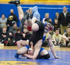 Gilbert's Nick Barber upends Northwestern's Marco Folino in the 138 lb. finals during the Berkshire-Valley Postseason Invitational held Saturday at the Gilbert School in Winsted. Jim Shannon Republican American