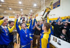 Gilbert hoists the NVL trophy after winning the league title during the Berkshire-Valley Postseason Invitational held Saturday at the Gilbert School in Winsted. Jim Shannon Republican American