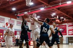 Wolcott's Jack Drewry #32 splits the defense of Ansonia's Sheldon Schuler #1 and Glenn Hines #10 going to the basket very late during a boys NVL basketball game between Ansonia and Wolcott at Wolcott High School in Wolcott on Wednesday. Bill Shettle Republican-American