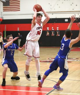 Cheshire High School's Aidan Godfrey passes to an open teammate over Southington High School's Ryan Gesnaldo, left, and Colin Burdette during the boys varsity basketball game at Cheshire High School on Friday, Feb. 15, 2019. Emily J. Reynolds. Republican-American