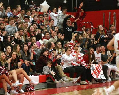Cheshire High School boys varsity basketball team fans cheer the team on the court during the game against Southington High School at Cheshire on Friday, Feb. 15, 2019. Emily J. Reynolds. Republican-American