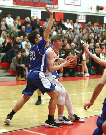 Cheshire High School's Aidan Godfrey drives to the basket through Southington High School's Jake Napoli during the boys varsity basketball game at Cheshire High School on Friday, Feb. 15, 2019. Emily J. Reynolds. Republican-American
