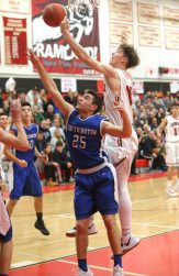 Cheshire High School's Aidan Godfrey goes up for a shot over Southington High School's Jacob Flynn during the boys varsity basketball game at Cheshire High School on Friday, Feb. 15, 2019. Emily J. Reynolds. Republican-American