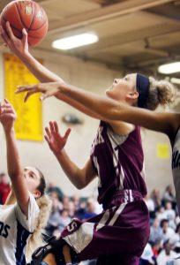 #0 Sarah Wisniewski of Naugatuck puts up a basket against Ansonia in overtime during the NVL girls basketball tournament in Waterbury Saturday. Steven Valenti Republican-American