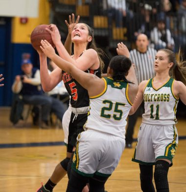 Watertown's Jordyn Forte (5) gets off a shot in front of Holy Cross' Ja'Lin Waters (25) and Hannah Brown (11) during their NVL semi-final game Monday at Kennedy High School in Waterbury. Jim Shannon Republican American