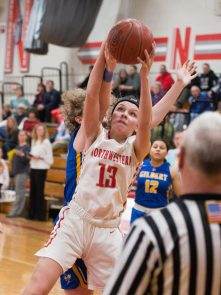 Northwestern's Emma Propfe (13) pulls down a rebound in the closing minute of their win over Gilbert during their Berkshire League semi-final game Tuesday at Northwestern Regional High School in Winsted. Jim Shannon Republican American