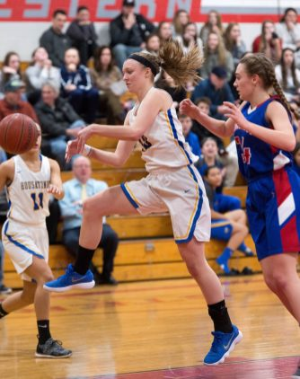 Housatonic's Caroline Hurlburt (10) tries to save the ball from going out of bounds in front of Nonnewaug's Maddie Woodward (34) during their Berkshire League semi-final game Tuesday at Northwestern Regional High School in Winsted. Jim Shannon Republican American