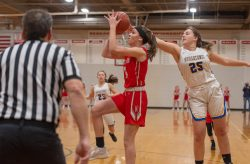 Northwestern's Emma Propfe (13) puts up a running shot after getting past Housatonic's Madelynn Olownia (25) in the Berkshire League tournament finals Friday at Northwestern Regional High School in Winsted. Jim Shannon Republican American