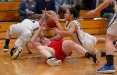 Northwestern's Natalie Lederman (22) and Housatonic's Sierra O'Niel (11) battle for a lose ball during the Berkshire League tournament finals Friday at Northwestern Regional High School in Winsted. Jim Shannon Republican American