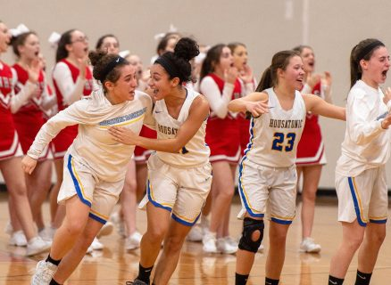 Housatonic's Anna Coon, left, and Sierra O'Niel (11) and Christina Winburn (23) celebrate their win over Northwestern to capture the Berkshire League tournament championship Friday at Northwestern Regional High School in Winsted. Jim Shannon Republican American