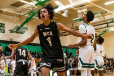 WCA's Jonathan Edwards #1 reacts by celebrating his team's win over Holy Cross and advancing to the semi-finals on Monday, during the boys NVL Conference Tournament between WCA and Holy Cross at Wilby High School in Waterbury on Saturday. Bill Shettle Republican-American