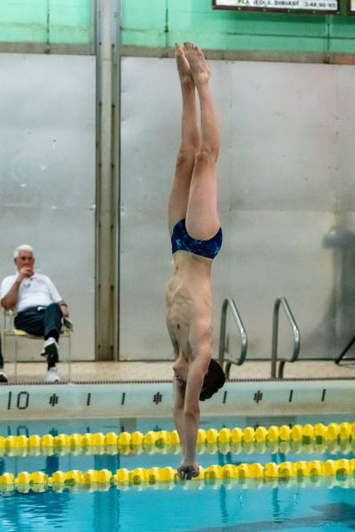Matheus Silva of Kaynor Tech enters the water perfectly vertical as he competes during the 2019 NVL Diving Championships at Kennedy High School in Waterbury on Wednesday. Matthew Silva placed third overall in the competition. Bill Shettle Republican-American