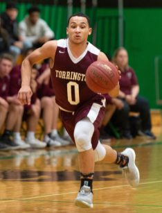 Torrington's Dontae Thomas (0) runs the ball up court during their NVL tournament finals game against Sacred Heart Wednesday at Wilby High School in Waterbury. Jim Shannon Republican American