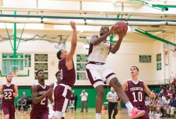 Sacred Heart's Nate Tabor (1) puts up a shot between Torrington's Dontae Thomas (0) and Joel Villanueva (10) during their NVL tournament finals game held Wednesday at Wilby High School in Waterbury. Jim Shannon Republican American