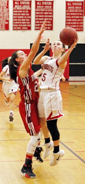 Pomperaug's Madison Villa (35) puts up a shot as Branford's Karly King (24) defends during the second round of the Class L tournament Thursday night at Pomperaug High School. Pomperaug defeated Branford 60-44. Michael Kabelka / Republican-American.