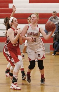 Pomperaug's Maggie Lee (33) looks to pass the ball as Branford's Sophia Araneo (20) defends during the second round of the Class L tournament Thursday night at Pomperaug High School. Pomperaug defeated Branford 60-44. Michael Kabelka / Republican-American.