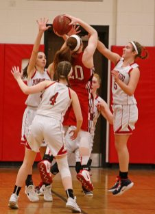 Pomperaug's defense thwarts Branford's Sophia Araneo (20) during the second round of the Class L tournament Thursday night at Pomperaug High School. Pomperaug defeated Branford 60-44. Michael Kabelka / Republican-American.