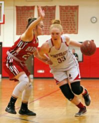 Pomperaug's Maggie Lee (3e) moves the ball as Branford's Gabriella Lucertini (23) defends during the second round of the Class L tournament Thursday night at Pomperaug High School. Pomperaug defeated Branford 60-44. Michael Kabelka / Republican-American.