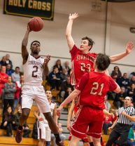Torrington's Ty Davis (2) puts up a shot over Stratford's Joseph August (23) and Jack Ryan (21) during their Division III second round game Thursday at Torrington High School. Torrington won 72-47 to advance. Jim Shannon Republican American