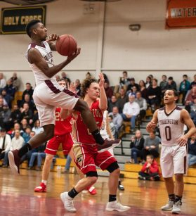 Torrington's Ty Davis (2) glides to the basket in front of Stratford's John Bike (25) during their Division III second round game Thursday at Torrington High School. Torrington won 72-47 to advance. Jim Shannon Republican American